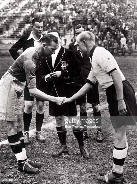 World Cup QuarterFinal San Siro Stadiun Milan Italy 31st May Germany 2 v Sweden 1 Sweden's captain Rosen shakes hands with German captain Szepan...