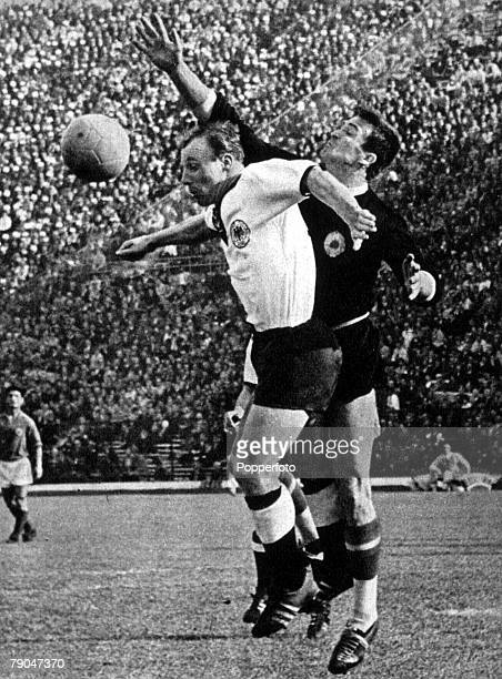 World Cup QuarterFinal Santiago Chile 10th June Yugoslavia 1 v West Germany 0 West Germany's Uwe Seeler fights for the ball with Yugoslavian...