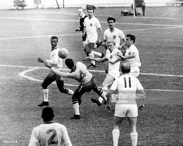 World Cup QuarterFinal Viva Del Mar Chile 10th June Brazil 3 v England 1 England defender Bobby Moore in the thick of the action against Brazil