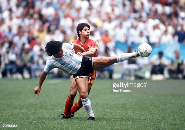 World Cup Semi Final Azteca Stadium Mexico 25th June Argentina 2 v Belgium 0 Argentina's Diego Maradona battles for the ball with Belgium's Enzo Scifo