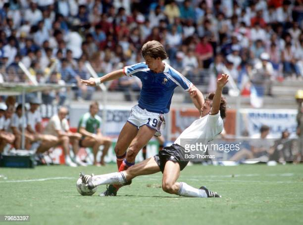 World Cup Semi Final Guadalajara Mexico 25th June West Germany 2 v France 0 France's Yannick Stopyra is challenged for the ball by West Germany's...