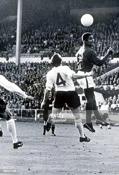 World Cup SemiFinal Wembley Stadium England 26th July England 2 v Portugal 1 England's Nobby Stiles watches as Portugal's Eusebio leaps for a header...