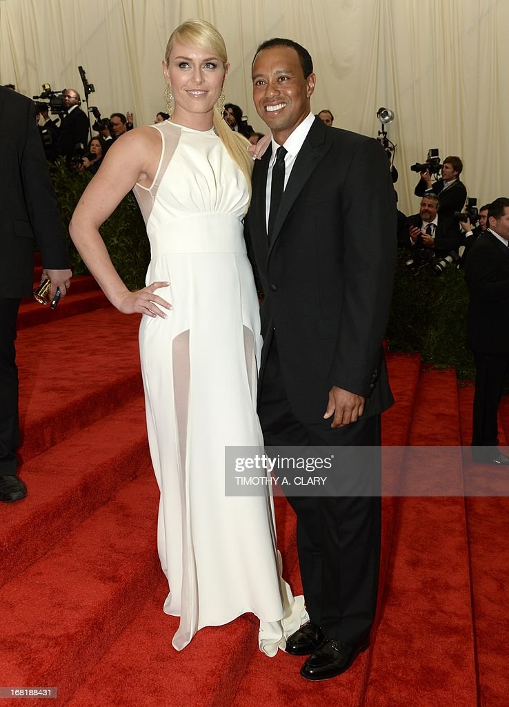 """World Cup skier Lindsey Vonn (L) and golfer Tiger Woods (R) arrive at the Metropolitan Museum of Art's Costume Institute Gala benefit in honor of the museum's latest exhibit, """"Punk: Chaos to Couture """" May 6, 2013 in New York. AFP PHOTO/Timothy A. CLARY"""