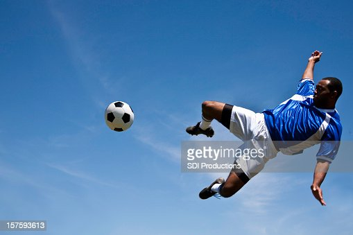 World Cup Soccer Player Kicking the Ball in Air