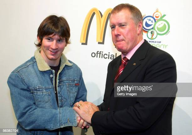 World Cup winner Sir Geoff Hurst of England shakes hands with Lionel Messi of Argentina and Barcelona during a FIFA Press conference prior to...