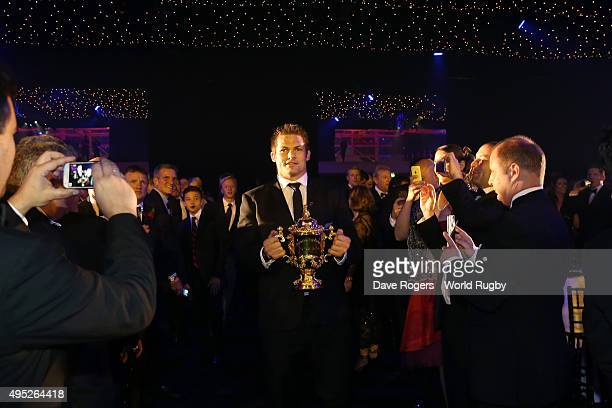 World Cup winning captain Richie McCaw of New Zealand arrives with the Webb Ellis Cup during the World Rugby Awards 2015 at Battersea Evolution on...