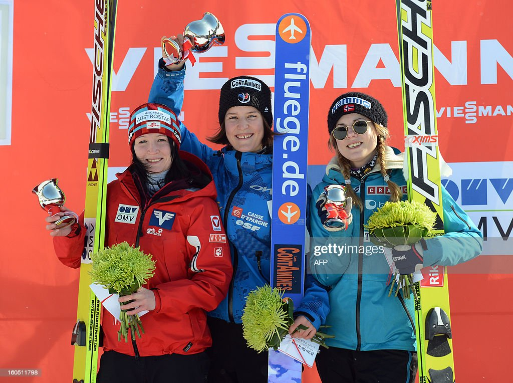 World Cup women's ski jumping medal winners (L-R) Austria's Jacqueline Seifriedsberger with silver, France's Coline Mattel with gold and Norway's Anette Sagen with bronze smile at the awarding ceremony in Sapporo in Japan's northern island of Hokkaido on February 2, 2013. Mattel captured her second win of the season to move up to second in the overall standings at the World Cup ski jumping event. AFP PHOTO / Takashi NOGUCHI
