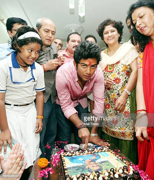 World Cupwinning India under19 cricket team captain Unmukt Chand cuts a cake at his residence in New Delhi on Thursday 30th August 2012