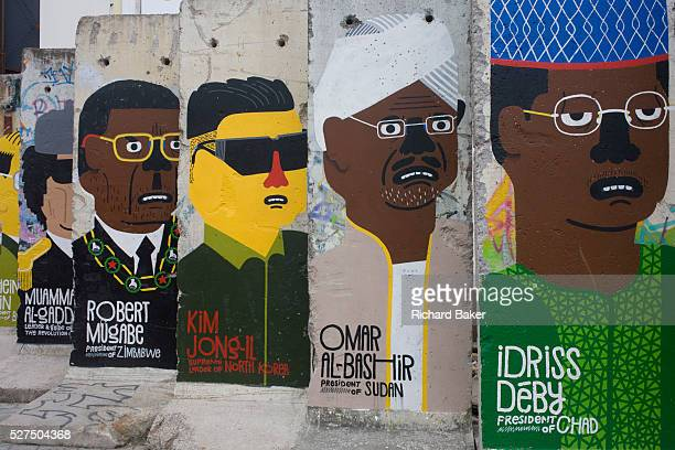 World dictators adorn old sections of the old Berlin Wall opposite the former Checkpoint Charlie the former border between Communist East and West...