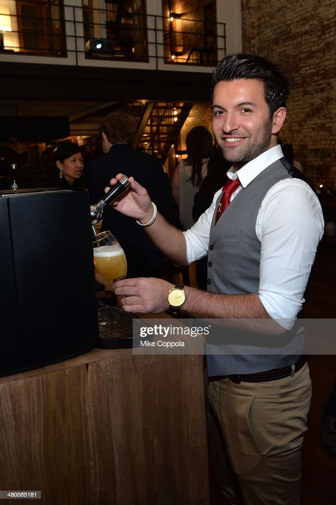 World Draught Master Allaine Schaiko demonstrates pouring at the Stella Artois PerfectDraft Home Bar celebration event on March 25, 2014 in New York City.