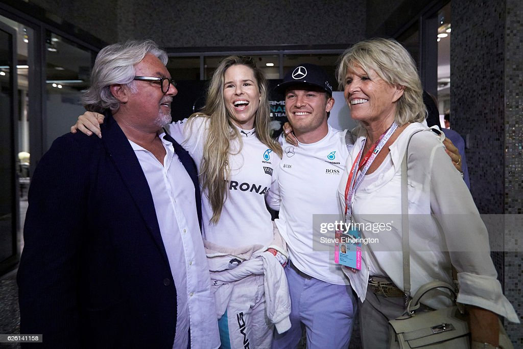 World Drivers Champion Nico Rosberg of Germany and Mercedes GP with father and former F1 Champion Keke Rosberg, his wife, Vivian Sibold and mother Sina Rosberg during the Abu Dhabi Formula One Grand Prix at Yas Marina Circuit on November 27, 2016 in Abu Dhabi, United Arab Emirates.