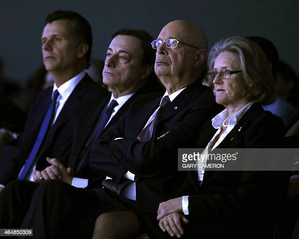 World Economic Forum founder Klaus Schwab and his wife Hilde listen to a speech by the US secretary of state at the World Economic Forum in Davos on...
