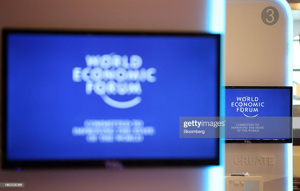 World Economic Forum logos are displayed on monitors at the Dalian International Conference Center in Dalian, China, on Tuesday, Sept. 10, 2013. The World Economic Forum Annual Meeting Of The New Champions 2013 will be held in Dalian from Sept. 11 to 13. Photographer: Tomohiro Ohsumi/Bloomberg via Getty Images