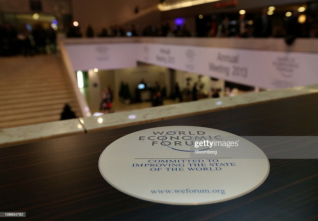 World Economic Forum (WEF) signage is displayed overlooking the main hall on the opening day in Davos, Switzerland, on Wednesday, Jan. 23, 2013. World leaders, Influential executives, bankers and policy makers attend the 43rd annual meeting of the World Economic Forum in Davos, the five day event runs from Jan. 23-27. Photographer: Chris Ratcliffe/Bloomberg via Getty Images