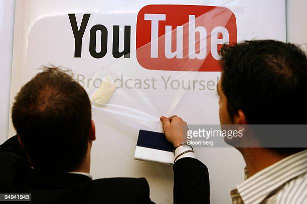 World Economic Forum staff members hang a YouTube sign on day one of the WEF annual meeting in Davos Switzerland on Wednesday Jan 28 2009 This year's...