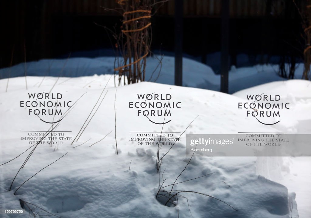 World Economic Forum's (WEF) logos are displayed on a window inside the Congress Centre ahead of the WEF meeting in Davos, Switzerland, on Sunday, Jan. 20, 2013. Next week the business elite gathers in the Swiss Alps for the 43rd annual meeting of the World Economic Forum in Davos, the five day event that will run from Jan. 23-27. Photographer: Chris Ratcliffe/Bloomberg via Getty Images