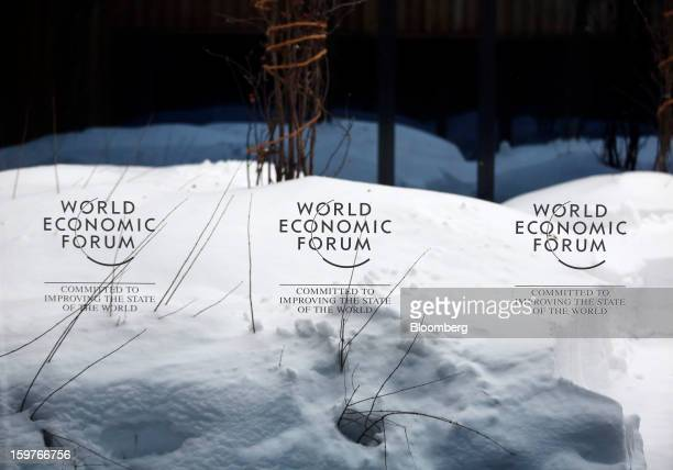 World Economic Forum's logos are displayed on a window inside the Congress Centre ahead of the WEF meeting in Davos Switzerland on Sunday Jan 20 2013...