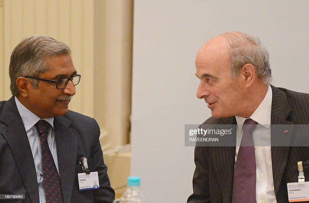 World Energy Council (WEC) Chairman Pierre Gadonneix (R) talks with Indian Union Secretary of Power P. Uma Shankar during the World Energy Leaders Summit in New Delhi on February 6, 2013. The World Energy leaders Summit is organised twice a year by the WEC to enable high-level dialogue on critical issues on energy resources and its sustainable supply.