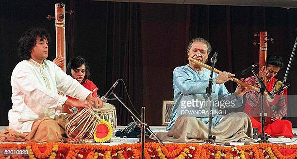 World famous Indian musicians Haridesai Chaurasia plays the flute and Jakir Hussain a pair of Tabla or percussion instruments in Kathmandu 20 January...