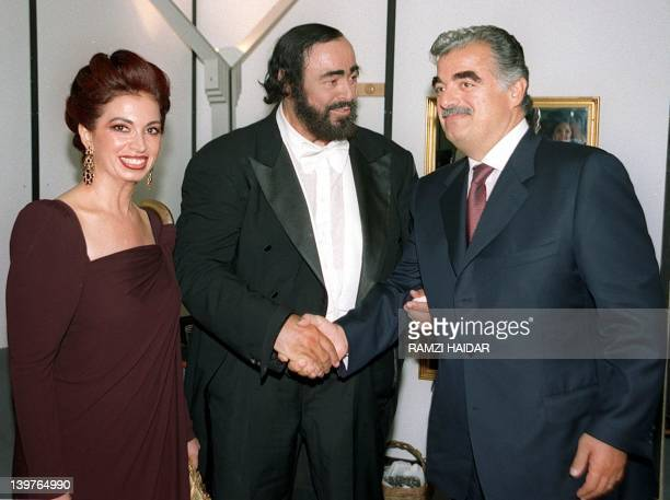 World famous tenor Luciano Pavarotti visits former Lebanese Premier Rafic Hariri and his wife Nazik 13 June 1999 at their home in Beirut before...