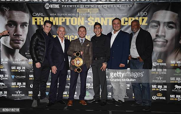 World Featherweight champion Carl Frampton pictured with Leo Santa Cruz alongside Barry McGuigan Shane McGuigan and Richard Schaefer during a press...