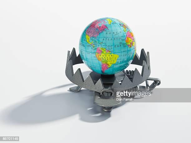 World globe in a trap