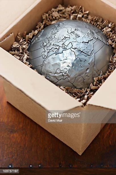 world globe in shipping box showing europe