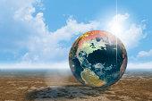 World globe on deserted plain
