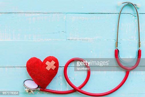 World health day, Healthcare and medical concept. Stethoscope and red heart on Pastel white and blue wooden table background texture. : Foto de stock