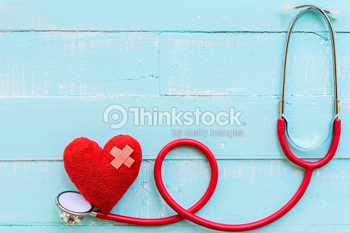 World health day, Healthcare and medical concept. Stethoscope and red heart on Pastel white and blue wooden table background texture. : Stock Photo