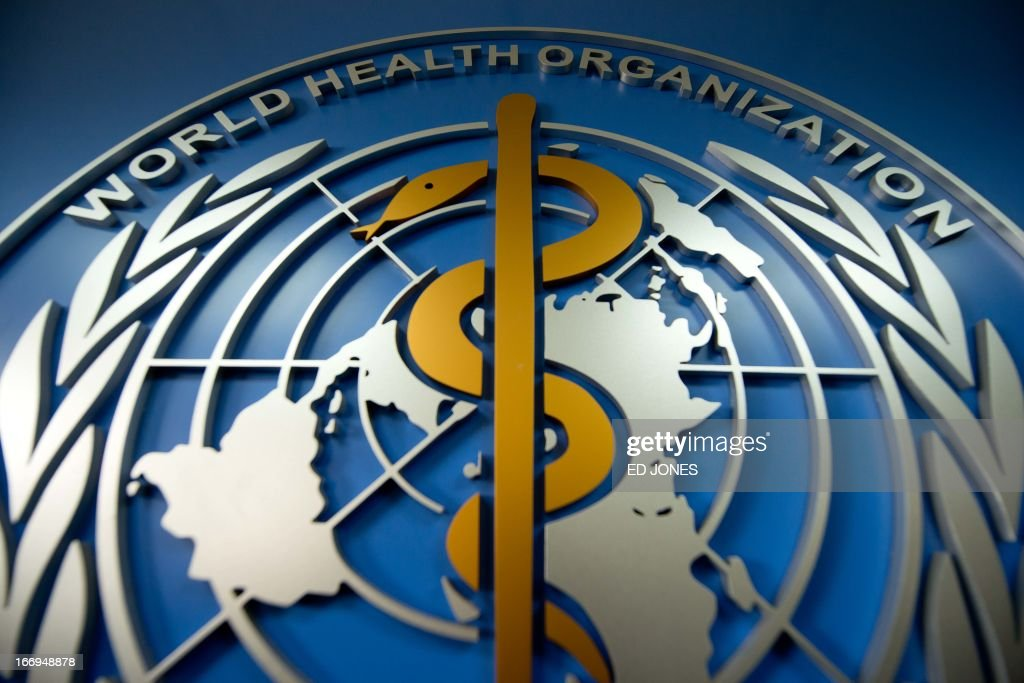 A World Health Organisation logo is displayed at their office in Beijing on April 19 2013 China has confirmed a total of 82 human cases of H7N9 avian...