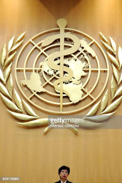 World Health Organization DirectorGeneral Margaret Chan delivers a speech under a giant WHO logo at the WHO's annual assembly attended by dozens of...
