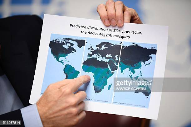 World Health Organization Executive Director of the Outbreak and Health Emergencies Cluster Bruce Aylward holds a map showing the predicted...