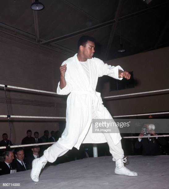 World heaveyweight champion Muhammad Ali shadow boxing in the ring during training at the White City drill hall London for the defence of his title...