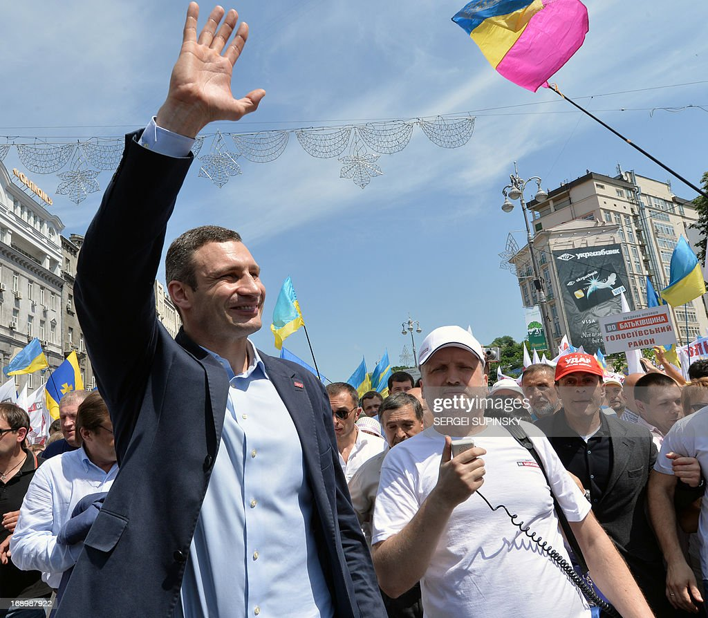 World Heavy Weight Boxing Champion and one of the leaders of Ukrainian opposition Vitaly Klitschko (L) greets supporters during an opposition rally 'Rise up Ukraine!' in the center of Kiev on May 18, 2013. Protestors demanded to free jailed former Ukrainian prime minister and leader of the opposition Yulia Tymoshenko and others political prisoners. AFP PHOTO/ SERGEI SUPINSKY