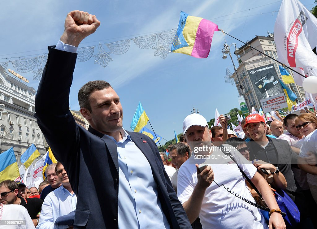 World Heavy Weight Boxing Champion and one of the leaders of Ukrainian opposition Vitaly Klitschko (L) greets supporters during an opposition rally 'Rise up Ukraine!' in the center of Kiev on May 18, 2013. Protestors demanded to free jailed former Ukrainian prime minister and leader of the opposition Yulia Tymoshenko and others political prisoners.