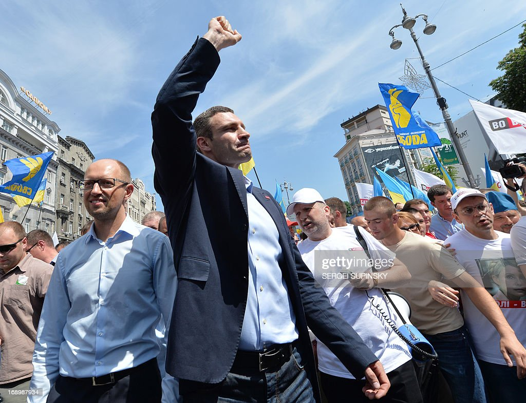 World Heavy Weight Boxing Champion and one of the leaders of Ukrainian opposition Vitaly Klitschko (C) greets supporters during an opposition rally 'Rise up Ukraine!' in the center of Kiev on May 18, 2013. Protestors demanded to free jailed former Ukrainian prime minister and leader of the opposition Yulia Tymoshenko and others political prisoners.