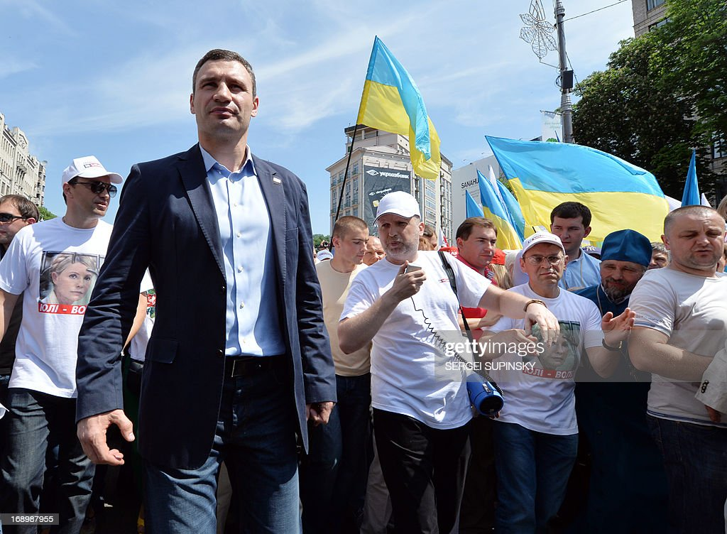 World Heavy Weight Boxing Champion and one of the leaders of Ukrainian opposition Vitaly Klitschko (L) takes part in an opposition rally 'Rise up Ukraine!' in the center of Kiev on May 18, 2013. Protestors demanded to free jailed former Ukrainian prime minister and leader of the opposition Yulia Tymoshenko and others political prisoners.