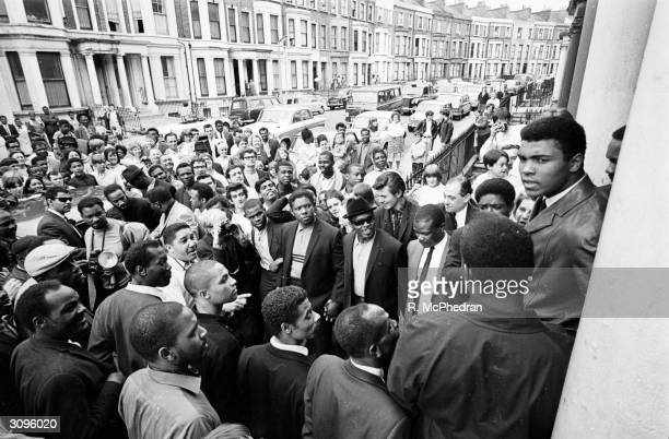 World heavyweight boxing champion Cassius Clay visiting the London Free School children's play group and families' group at 34 Tavistock Crescent the...