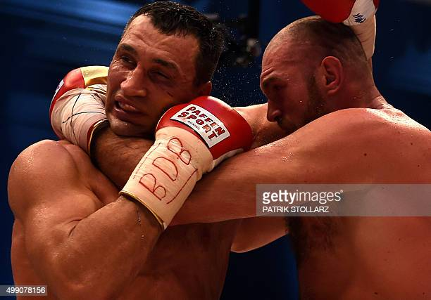 World heavyweight boxing champion Wladimir Klitschko of Ukraine defends against Britain's Tyson Fury during their WBA IBF WBO and IBO title bout in...