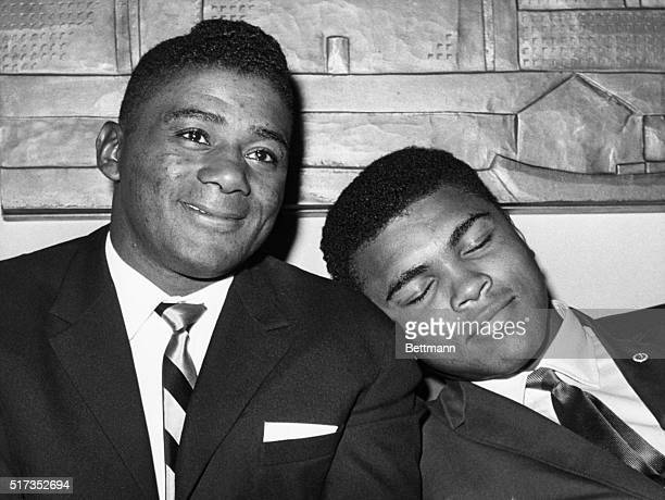 World heavyweight champion Cassius Clay later known as Muhammad Ali naps on the shoulder of former champion Floyd Patterson during a press conference...