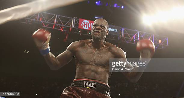 World Heavyweight Champion Deontay Wilder celebrates his knockdown of Eric Molina at the Bartow Arena on June 13 2015 in Birmingham Alabama