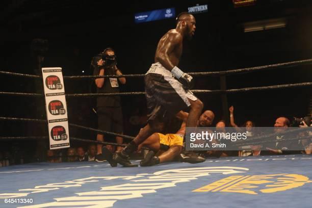 World Heavyweight Champion Deontay Wilder knocks down Gerald Washington at Legacy Arena at the BJCC on February 25 2017 in Birmingham Alabama