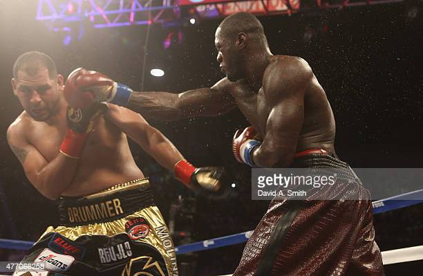 World Heavyweight Champion Deontay Wilder throws a punch to Eric Molina at the Bartow Arena on June 13 2015 in Birmingham Alabama