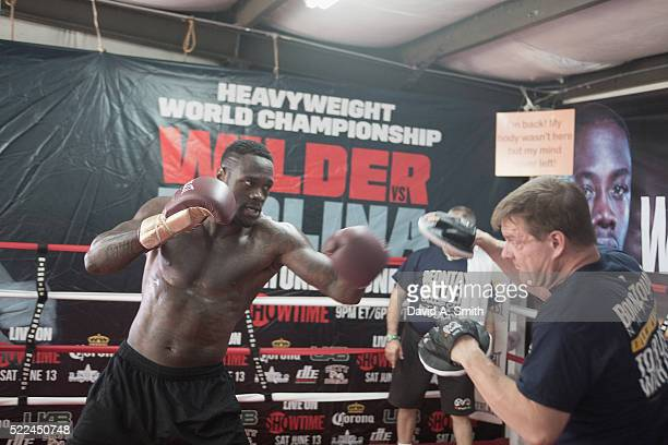World Heavyweight Champion Deontay Wilder works with trainer Jay Deas during a media session at Skyy Boxing on April 19 2016 in Northport Alabama
