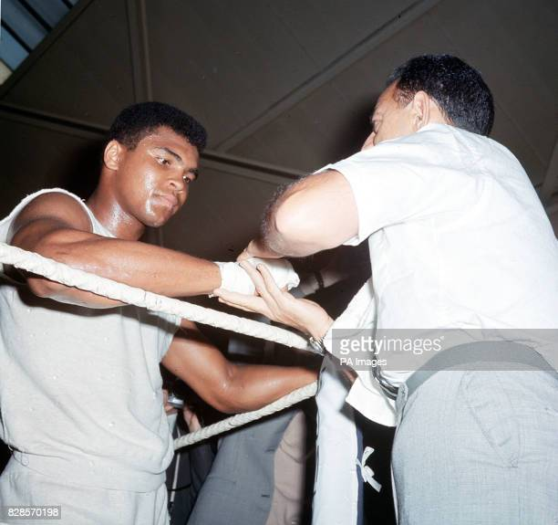 World heavyweight champion Muhammad Ali shadow boxing in the ring during training at the White City drill hall London for the defence of his title...