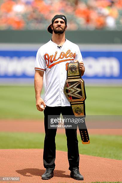 World Heavyweight Champion Seth Rollins looks on before throwing out the first pitch before a baseball game against the Los Angeles Angels of Anaheim...