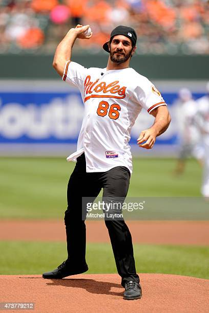 World Heavyweight Champion Seth Rollins throws out the first pitch before a baseball game against the Los Angeles Angels of Anaheim at Oriole Park at...
