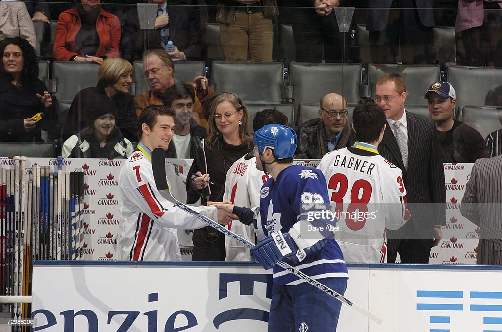 World Junior Championship gold medal winner from Team Canada Steve Downie shakes hands with Jeff O'Neill of the Toronto Maple Leafs before the game...