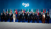 World leaders and delegates pose for a family photograph at the Group of 20 summit in Brisbane Australia on Saturday Nov 15 2014 Front row from left...